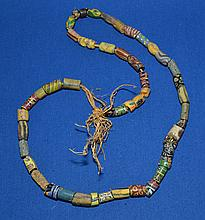 AFRICAN TRADE BEAD NECKLACE  African millefiore glass trade bead necklace.  45 beads. Sizes 1/4 - 3/4''L. Necklace 26''L.  Condition all jewelry sold as is.