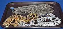 3 COSTUME JEWELRY BELTS. Lot includes; (1) silver mesh belt with rhinestone clasp. (1) gold link chain belt. (1) silver link threaded with leather belt with floral rhinestone clasp, tassel end. Condition: all jewelry sold as is.