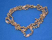 GOLDEN PEARL AND PINK QUARTZ BEAD MULTI STRAND NECKLACE WITH 14k CLASP. 10-''L. Condition: all jewelry sold as is.