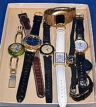 LOT OF WATCHES 9 PIECES. Lot includes: (1) Manhattan diamond Quartz watch with leather band. (1) Dejuno quartz watch with leather band. (1) Joan Rivers classic watch with black leather band. (1) Gruen quartz watch with white leather band. (1) Venice