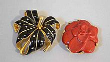 2 REPLICA BROOCHES. 2 Replica designer brooches made in Italy. Includes: (1) red coral floral brooch. 1 3/4''Diam. (1)black enamel and rhinestone lily pin. 2 1/4''H, 2''W. Condition: all jewelry sold as is.