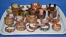 COPPER AND BRASS CUFF BRACELETS. 28 PIECES. Condition: all jewelry sold as is.