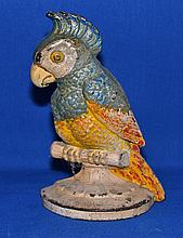 PARRPT DOORSTOP   polychrome metal doorstop in the form of a parrot.  8 1/4'' hieght.  No Marking. Condition age appropriate wear.  Wear to painted surface.