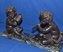 PAIR BRONZE PUTTI SCULPTURES ON MARBLE BASES   Pair of Bronze putti playing musical instruments set on rectangular mottled green marble bases.  12'' hieght.  11'' wide base.  5 3/4'' deep base.  No Mark. Condition age appropriate wear.