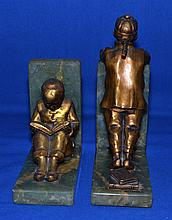 CHINESE ART DECO BOOKENDS.   Art Deco Bookends.  Gilt Metal.  Chinese children with books.  Set on green onyx bases.  (1) 9'' hieght.  (1) 5 3/4'' hieght.  No Mark.  Condition age appropriate wear.