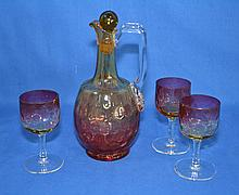 AMBERINA DECANTER AND GLASSES LOT 4 PIECES Four amberina or rose amber inverted thumb print artglass items. Lot includes: Decanter with clear applied handle. Ground and polished pontil. 9 1'2'' hieght. Three (3) wine glasses. 4 3/4'' hieght. 2 1/4''