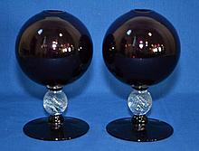 PAIR AMETHYST GLASS IVY BALLS   Pair amelthyst and clear glass ivy balls.  Ribbed ball stems. Polished top rim.  7'' hieght.  4 1/4'' diam. widest part.  3 7/8'' diam. base.  No Mark. Condition age appropriate wear.