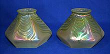 TWO (2) ART GLASS SHADES Two art glass shades with pull feather irridescent decoration. Green/Gold tonality. Six (6) sides body. 3 3/4'' hieght. 2 1/4'' diam. filter ring. 5 1/2'' diam. widest part. 4'' diam. rim. No Mark. Condition age appropriate