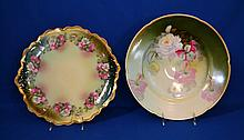 TWO BAVARIAN PORCELAIN CHARGERS 1 Porcelain charger with scalloped rim. Hand painted floral band on shaded ground. 12 1/2'' diam. Mark Z.S & Co. Bavaria. Condition age appropriate wear. Small chip in rim. 1 Percelain charger with shaded green ground