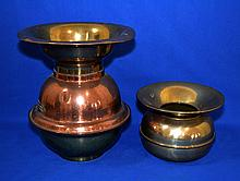 TWO (2) VINTAGE SPITOONS Lot includes 1 Brass and copper tall spitoon with label mark ''Goldfield Hotel Goldfield Nevada''. 11 1/2'' hieght. 10'' diam. top. 1 Small brass spitoon 5 3/4'' hieght. 8 '' diam. top. No Mark. Condition age appropriate