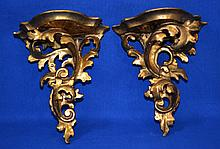 PAIR GILT WOOD WALL BRACKETS   Pair  Rococo style acanthus leaf scroll form wall brackets.  Gilt dessoed wood.  7 1/2'' hieght.  6 1/2'' diam. top.  4'' deep top.  No Mark. Condition age appropriate wear.