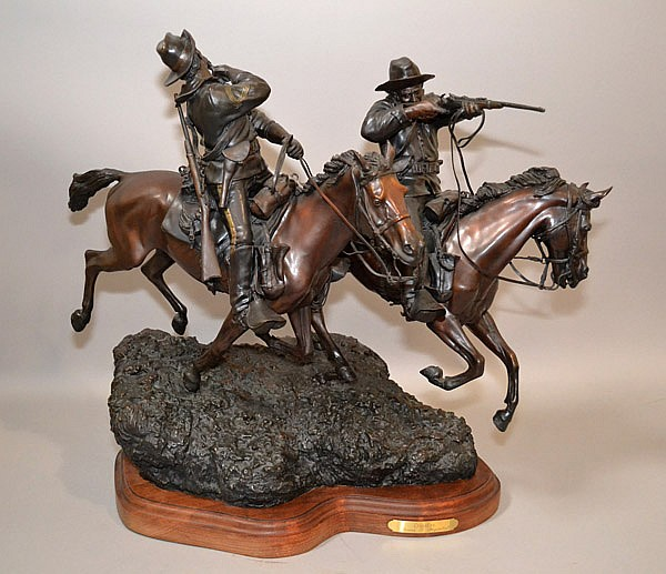 ''CROSSFIRE'' BY JAMES P. REGIMBAL. Spectacular Western Bronze Sculpture entitled ''Crossfire'' by James P. Regimbal. A limited edition of only 35 which this is 26/35 and dated 1983. The bronze depicts two mounted cavalrymen from the 1870's, the lead