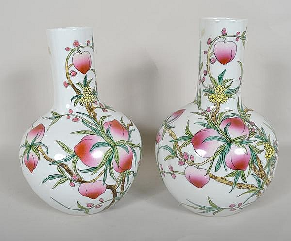PAIR CHINESE FAMILLE ROSE VASES. Pair of bulbous bottle form vases with similar decoration of flowering branch and peach decoration. Marked: red six Character Chien Lung style seal mark. Size: 13 1/2''H, 3 1/4''diam. top, 9''diam. widest part, 4