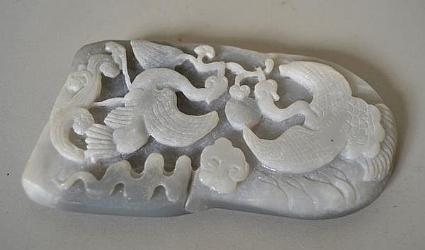 CHINESE CARVED JADE PLAQUE. Mottled grey jade plaque, scene of two cranes holding branch in their beaks. No mark. Size: 4 1/2''H, 2 1/2''W, 1/2''deep. Condition: age appropriate wear.