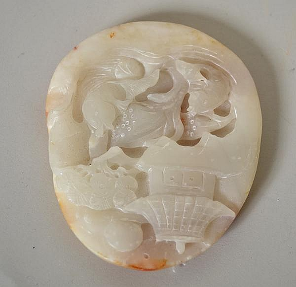 CHINESE CARVED JADE PLAQUE. Carved white jade plaque with brown inclusions on back. lower section with carp, pagoda and moon on top, hole in top for hanging. No mark. Size: 4''H, 3 1/4''W, 1/2''Thick. Condition: age appropriate wear.