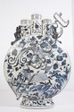 CHINESE BLUE AND WHITE TULIPIERE FOOTED MOON FLASK. Chinese blue and white porcelain tulipiere footed moon flask, central open spout flanked by two closed spouts, phoenix and stag decorated front and back, oval foot. No mark. Size: 18''H, 2 1/2''W. 3