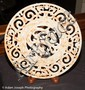 JADE BI DISK. Chinese carved jade archaic form bi disk, stylized dragon and scroll decoration. No mark. Size: 11 1/2''Diam. Condition: age appropriate wear. 2840.