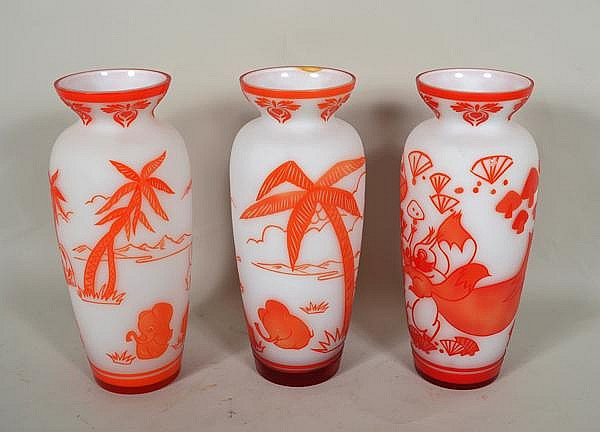 CHINESE PEKING OVERLAY GLASS LOT 3 PIECES. Three Chinese Peking overlay glass vases, orange cut to white frosted, waisted neck, body decorated with cartoon-like animals, decorated neck, solid top and base band. No mark. Size: 10 1/4''H, 3 1/2''Diam.