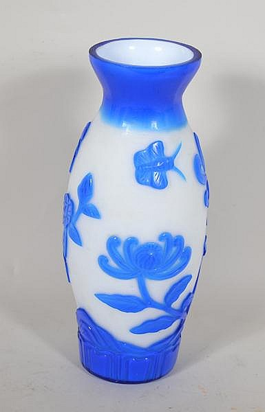CHINESE PEKING OVERLAY GLASS VASE. Blue cut to white frosted glass overlay vase, chrysanthemum blossoms and bird on branch, acid cut and molded flowers and decorative base, polished bottom. No mark. Size: 9 1/4''H, 2 3/4''Diam. top, 4''diam. widest