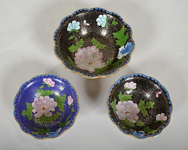 3 CHINESE CLOISONNE BOWLS. Set of three cloisonne bowls with scalloped top rim. Includes: (1) blue ground with wire cloud pattern and polychrome peony blossoms. No mark.Size: 1 3/4''H, 5''diam. top, 2''diam. base. (1) blue ground with wire cloud