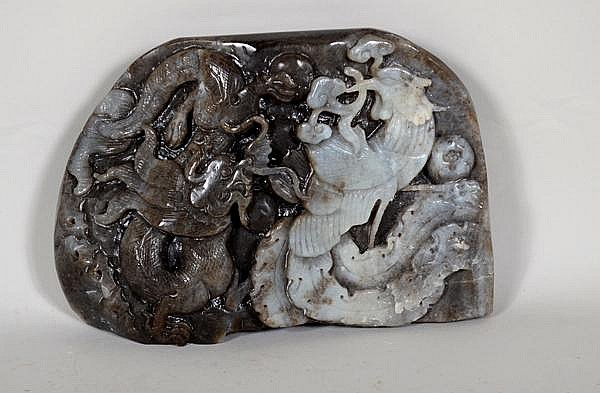 CHINESE CARVED JADE MOUNTAIN. Mottled celadon and brown jade carving depicting dragon and phoenix. No mark. Size: 4 1/2''H, 6 1/2''W, 1 1/4''Deep. Condition: age appropriate wear.