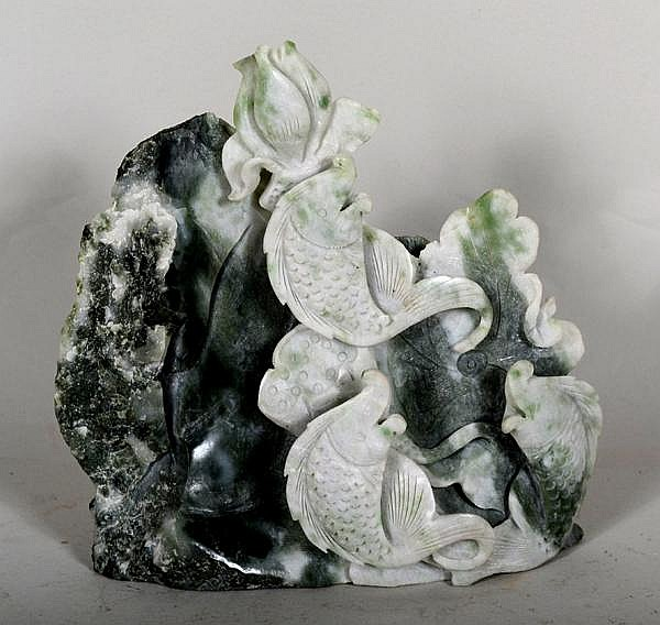 CHINESE CARVED JADE MOUNTAIN GROUP. Mottled white and dark green stone carving of leaping carp and lotus blossom. No mark. Size: 5 3/4''H, 5 3/4''W, 1 3/4''Deep. Condition: age appropriate wear.