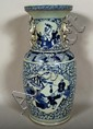 CHINESE BLUE AND WHITE PORCELAIN VASE. Blue and white baluster from porcelain vase, flaring rim, 2 reserve panels, one with woman and child, one with deity on kylin, pierced foo dog handles, glazed bottom. No mark. Size: 18''H, 7''Diam. top, 9''Diam.