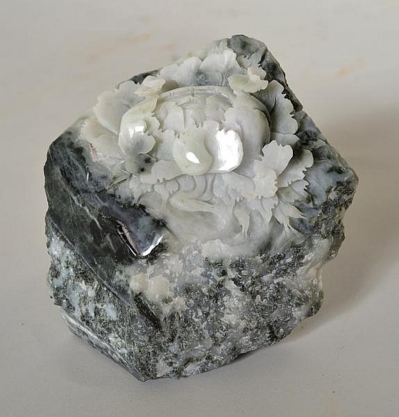 CHINESE CARVED JADE MOUNTAIN. Mottled dark green and white jade stone, top carved with detailed peony blossom. No mark. Size: 4''H, 4 1/2''W, 3''deep. Condition: age appropriate wear.