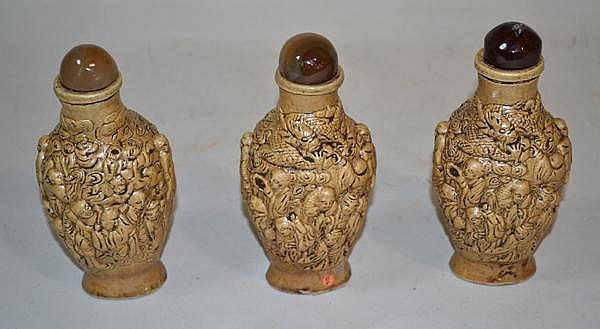 3 LARGE MOLDED PORCELAIN SNUFF BOTTLES. Lot of three brown glazed molded snuff bottles. Size; 6