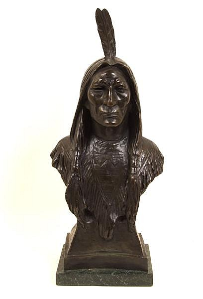 MAX BACHMANN (1862-1921) Bust of a Native American Indian brave, patinated bronze, signed Max Bachmann, raised on green marble base. Condition: no visible defects. Height: 21'', with base 22 1/2''.