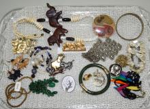 ASSORTED COSTUME JEWELRY - Includes jade, carved wood, shell and beaded - Condition: Age appropriate wear; All items sold as is.