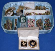 ASSORTED COSTUME JEWELRY - Includes bracelets, necklaces, rhinestones and religious - Condition: Age appropriate wear; All items sold as is.