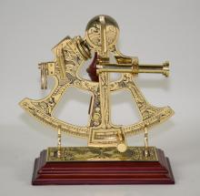 BRASS SEXTANT BY JESSE RAMSDEN - On stand, in original box; Measures: 7.5''H x 7''W - Condition: Age appropriate wear; All items sold as is.