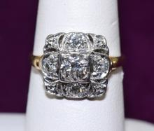 PLATINUM & DIAMOND RING - Center stone approx .55 pts, (4) surrounding stones approx .40 pts, total approx 1.0 ctw; Size 7.5; Total weight: 2.8 dwt - Condition: Age appropriate wear; All items sold as is.