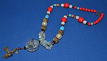 CHINESE BEAD AND REVERSE PAINTED GLASS NECKLACE  Chinese necklace with metal and colored beads. Reversed painted glass pendant. 24''L. Pendant drop 4 1/2''. No Mark. Condition all jewelry sold as is. (L#266)
