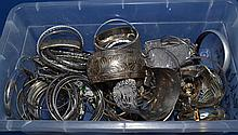 SILVER TONE BANGLE BRACELETS  Lot bin of misc. silver tone bangles. Various designs. No Mark. Condition all jewelry sold as is. (L#304)