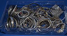 SILVER TONE BANGLE BRACELETS  Lot bin of misc. silver tone bangles. Various designs. No Mark. Condition all jewelry sold as is. (L#300)