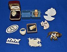 IVORY JEWELRY 10 PIECE LOT   Includes, 3 rings, 1 charm and 6 carved ivory pins. Condition, age appropriate wear. All jewelry sold as is.
