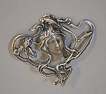 STERLING ART NOUVEAU BROOCH  Sterling Art Nouveau Brooch of Young Woman's Head.  1 1/2''H.        1 3/4''W. Mark, 925.  Condition, age appropriate wear.  All jewelry sold as is.