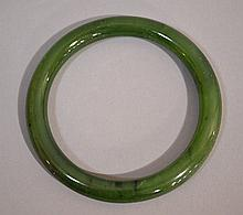 GREEN JADE BANGLE BRACELET  Dark green jade bangle bracelet. 3'' outer diam. 2 3/8'' inner diam. No Mark. Condition, age appropriate wear. All jewelry sold as is.