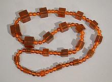 AMBER NECKLACE  Alternating graduated square & round beads. 28''L. No Mark. Condition, age appropriate wear. All jewelry sold as is.