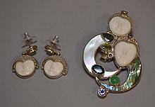 SAJEN STERLING & GEMSTONE BROOCH AND EARRINGS  Each with goddess faces. Mark, Sajen Sterling.  Condition, age appropriate wear. All jewelry sold as is.
