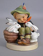 HUMMEL FIGURINE ''BOY WITH RABBIT''  Boy with Basket of Rabbits.  4''H. Mark, Early Mark.  Condition, age appropriate wear.