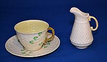 BELLEAK PORCELAIN LOT 3 PIECES  Lot includes, 2 Cup & Saucer. Shamrock pattern, 3 1/2''diam.cup.  5 5/8''diam.saucer.  1 Fish scale creamer. 4''H. Mark, Belleak Ireland. Condition, age appropriate wear.