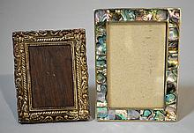 PAIR OF EASEL BACK PICTURE FRAMES   1 Abalony and Silver. 4''x6''. 1 Teakwood with pressed silver face. 4''x5''. No Mark. Condition, age appropriate wear. Item sold as is.