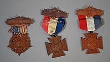CIVIL WAR VETERANS MEDALS LOT 3 PIECES Lot includes, 1 (1880) Ladies of the Grand Army of the Republic F.C.L. Medal with Ribbon. 2 1/4''L. 2 (1883) Women's Relief Corp. F.C.L. Medal with Ribbon. 3''L. No Mark. Condition, age appropriate wear. Item
