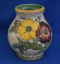 ROYAL GOUDA ART POTTERY VASE  Pottery Vase with hand painted polychrome floral decoration. 6 1/2''H. 3 1/2''diam.top. 6''diam.widest part. 3 3/4''diam.base. Mark, Royal Gouda Art Pottery Holland. Condition, age appropriate wear.