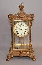 ANSONIA CRYSTAL REGULATOR CLOCK Ansonia crystal regulator clock. Gilt metal and beveled glass body. Key wind pendulum driven, half hour strike. Faux mercury pendulum. 16 1/4''H. 8 3/4''W.base. 7 1/2''D.base. Mark, manufactured by Ansonia Clock Co.