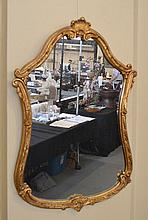 GILT GESSOED MIRROR  Shield shaped mirror with gilt gessoed wood frame.  36 1/2''H. 25''W.widest part. No Mark. Condition, age appropriate wear.
