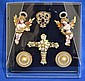 LEE YOHO JEWELED CROSS WITH ANGELS ARTWORK. Lee Yoho creation with pearl encrusted cross, two hand painted angles, medallions and other ornaments mounted on velvet in black metal frame under lucite shadowbox frame. Marked: Original Handcrafted